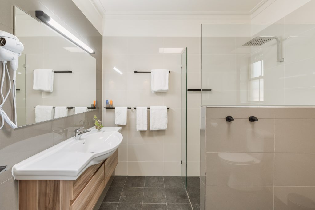 King studio bathroom with large walk in shower